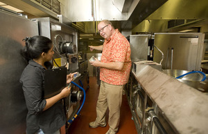 Michael Godfrey, associate dean, and Chitra Perera discuss the renovation The Restaurant at Kellogg Ranch.