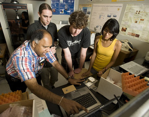 Engineering professor Vilupanur A. Ravi talks with his research team, which includes Andrew Schissler, Brad Harrison and Gizelle Cuevas.