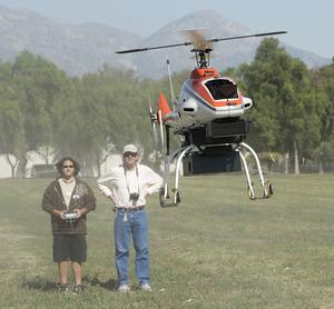 Hovig Yaralin, a sophomore aerospace engineering major, and Don Edberg take the R-Max UAV helicopter