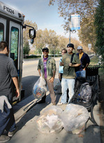From left: Josue Gamez, Christian J. Murillo C., Gina Hosterman, and Gary Liu help clean up a bus stop.