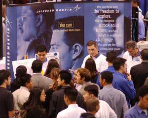 Job seekers jam the Lockheed Martin booth during the annual Engineering and High-Tech Job Fair in 2003.