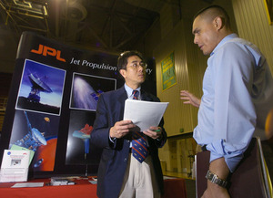 A recruiter from the Jet Propulsion Lab talks with a student at the Engineering and High-Tech Job Fair in 2005.