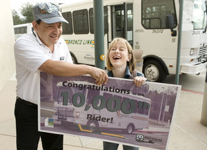 Dave Flores, Rideshare coordinator, congratulations Sarah Maso for being the 10,000th Bronco Link rider.