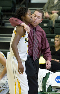 Head coach Scott Davis consoles Stephisha Walton after she fouls out of the CCAA Tournament semifina