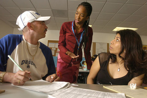 JusticeCorp volunteer and Cal Poly Pomona political science student Carmen Franklin works with Arturo Huerta and Noeli Pina at the Los Angeles County Superior courthouse in Pomona May 25, 2005.