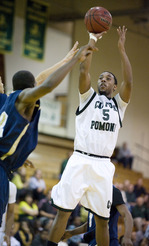 Dahir Nasser gets a shot off during the Bronco's win over Cal State Monterey Bay on Feb. 26, 2010.