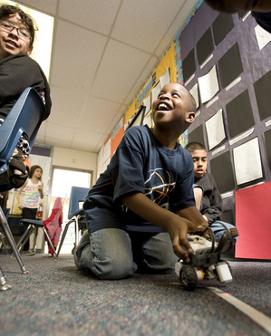 Barfield student Mykel Brown takes his robot off for a test drive on Feb. 23, 2010.