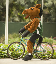 Billy Bronco rides a bike during an Earth Day event in 2009.