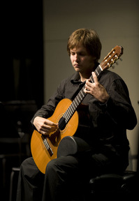 "Josh Endres performs ""La Catedral"" during the Guitar Ensemble recital on June 2, 2009."