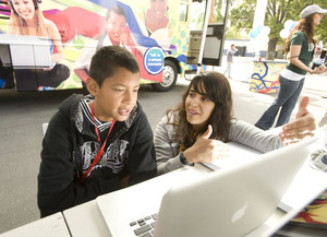 Biology major Monica Santander talks with Ricky Montano during the CSU's Road to College tour stop at Emerson Middle School.