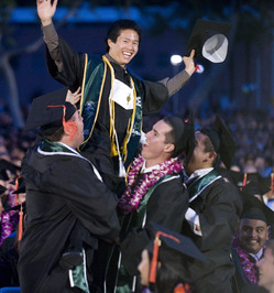 Ronald Indradjaja gets a lift during the College of Engineering commencement ceremony in 2009.