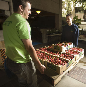 Farm Store employees move a pallet of strawberries at a market in the Kaiser Permanente offices in Pasadena on May 12, 2010.