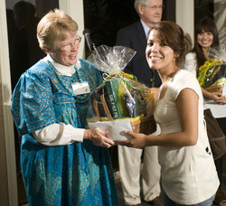 Sarah Ludwick presents student with a gift during reception for Renaissance Scholars on Sept. 26, 2008.