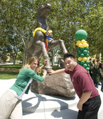 Amanda Smith and Chris Chen pat the Bronco statue's hoof following its unveiling on May 26, 2010.