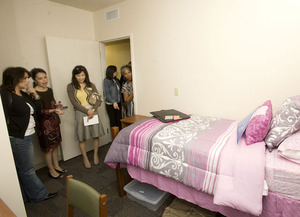 Visitors tour a room in the new Residential Suites Phase II on May 26, 2010.