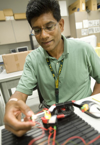 Mechanical engineering Professor Jawaharlal Mariappan tests a light sensing machine.