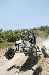 The 2010 SAE Baja car leaps over the dirt terrain on June 14, 2010.