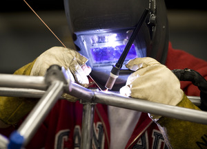 Andrew Tan, a senior mechanical engineering major, welds joints on the SAE Formula car on April 10, 2009.