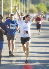 Jeannyna Flores crosses the finish line during the 2009 Matt's Run.
