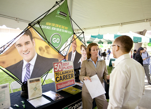 A recruiter from Enterprise Rent-A-Car talks with a student at 2009 Spring Career Day.