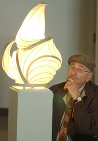 "George Stavros, professor in the English & foreign languages, admires ""Untitled table lamp"" by William Leslie at the W. Keith & Janet Kellogg University Art Gallery. Stavros passed away Sept. 22, 2010."