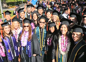 A shot of graduates from the video for the comprehensive campaign.