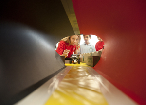 Alisa Kidwell of Whittier Christian watches as robot starts its journey through the obstacle course at the Robot Rally on May 5, 2011.