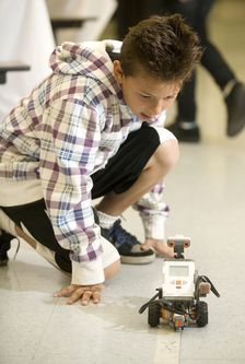 Fernando Acosta watches as his robot tries to complete a challenge at Montvue Elementary School in Pomona on Nov. 16, 2009.