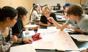 Svetlana Stouklova works with students in her Physics 131 recitation class February 23, 2012.