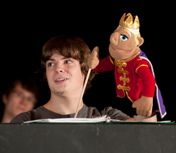"A student holds a puppet during rehearsal of ""Once Upon a Mattress"" on March 26, 2012."