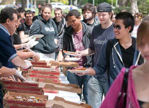 Students line up for free pizza in the University Quad during Pizza with the Presidents April 24, 2012.