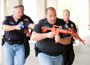 Police officers move into the engineering building during active shooter drill at Cal Poly Pomona May 23, 2008.
