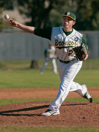 Erick Ruvalcaba pitches during the Broncos game against Concordia February 10, 2012.
