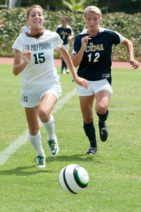Angela Garcia outruns Samantha Myers for the ball during the Broncos scrimmage against Cal Baptist University August 22, 2012.
