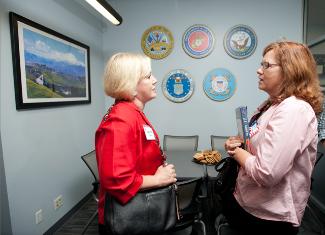 Betty Ortiz speaks with Christine Featherstone during a tour of the new Veterans Resource Center at Cal Poly Pomona October 4, 2012.