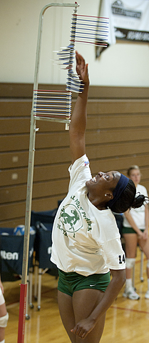 Sinead Palmer measures her vertical leap during volleyball practice.