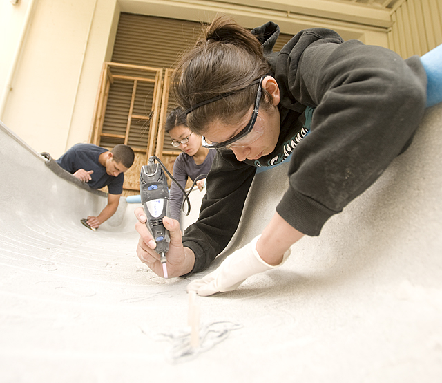 Diana Valdovinos, Mylana Nguyen and Steven Saleh work on Isis, Cal Poly Pomona's entry for the ASCE National Concrete Canoe Competition. The team will compete at the University of Nevada, Las Vegas.