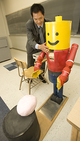 Jon Mao and Buster, his Robotic Nutcracker, during the 10th Annual Project Symposium at the College of Engineering at Cal Poly Pomona