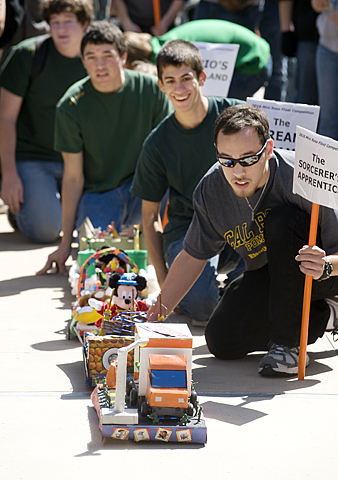 Kyle Stovner gets his float in line during EGR 100 Mini Rose Float Competition. Freshman engineering majors built the floats which were judged on animation, mobility, creativity, and design.