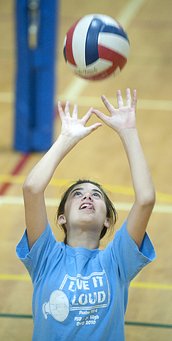 Madeline Kagle, age 12, sets a ball during volleyball camp at Cal Poly Pomona.