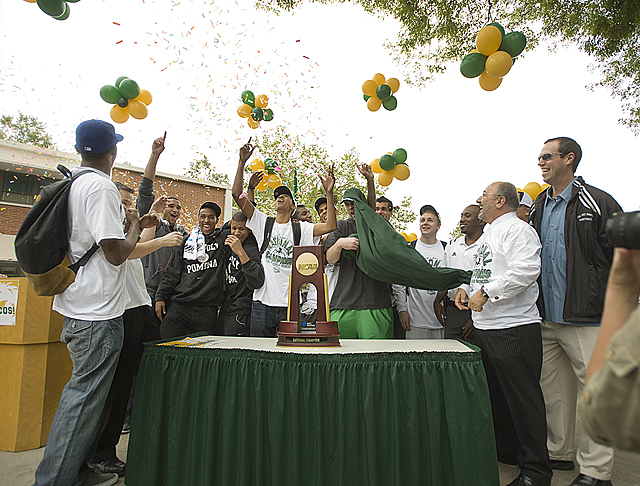 The trophy is unveiled during a homecoming rally for the men's basketball team celebrating their  NCAA Division II national championship at Cal Poly Pomona.
