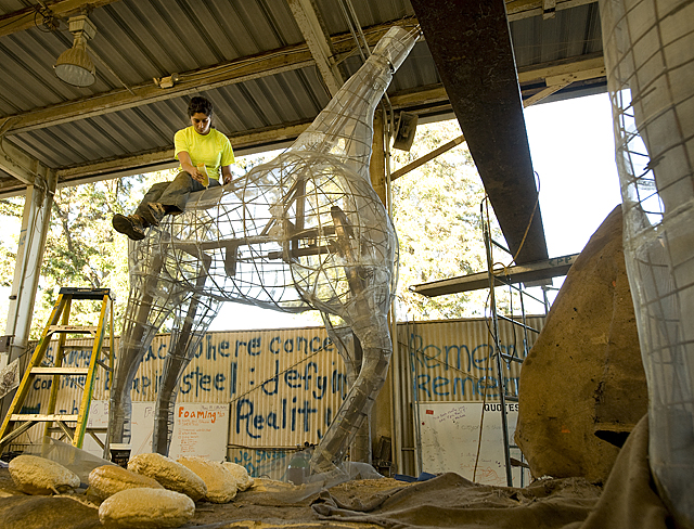 Sabrina Wise glues screen to a giraffe on the 2010 Cal Poly Universities rose float.
