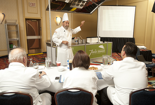Dr. Jeff Brown  delivers a lecture and cooking demonstration for judges as he wins the National Chef Educator of the Year at the American Culinary Federation National Convention at the Anaheim Marriott.