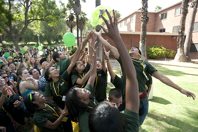 Students leap for a promotional tshirt during the Giant Jumpin' Jubilee on the Encinitas Hall lawn during 2010 Welcome Week for incoming freshman at Cal Poly Pomona.