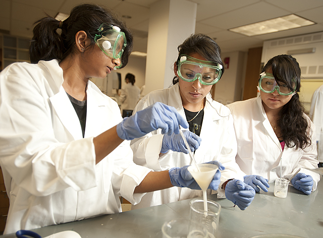 Cynthia Guevara, a Cal Poly Pomona chemistry major, center, helps Dilmini Weerasinghe and Crystal Guevara as they make soap as part of the STEM Learning Community Workshop at Cal Poly Pomona..