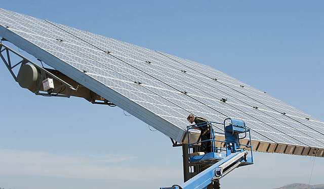 David Dutra, a mechanical engineer, inspects solar panels undergoing testing at the Lyle Center for Regenerative Studies at Cal Poly Pomona.