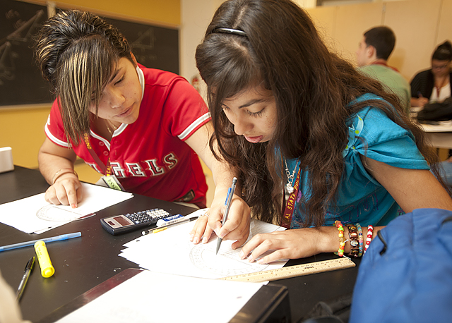 Clarissa Contreras and Mayra Rodriguez work on a physics problem during their Upward Bound class at Cal Poly Pomona.
