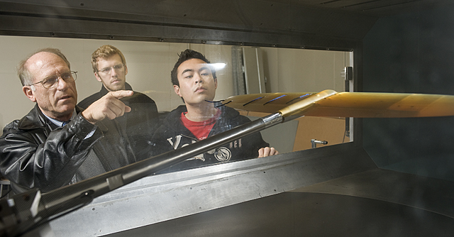 Aerospace Engineering Professor Steven Dobbs explains airflow over a wing to students Matt Sipek and Ken Orleans at the subsonic wind tunnel in building 13 at Cal Poly Pomona.