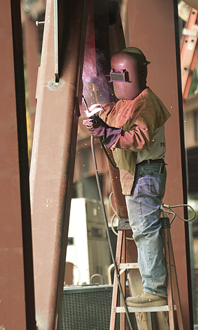 A welder works on the new Business Building under construction at Cal Poly Pomona