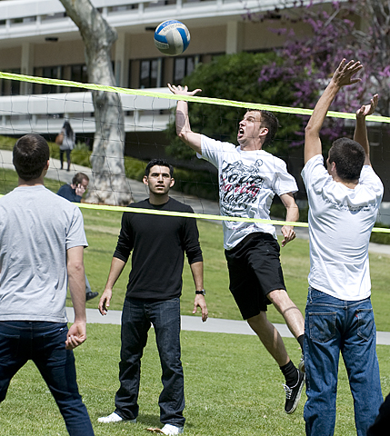 Students play volleyball near the TKE fraternity tent in the Quad during University Hour.